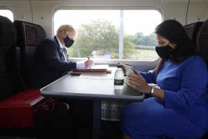 Boris Johnson Prime Minister and Priti Patel Home Secretary working on the Train 30 July 2020