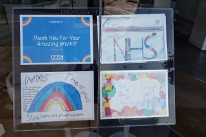 Rubicon Estate Agents window in Docklands, London with NHS drawings