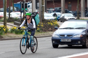 Deliveroo Rider Taking The Lane In Bristol - A top UK Tech Company