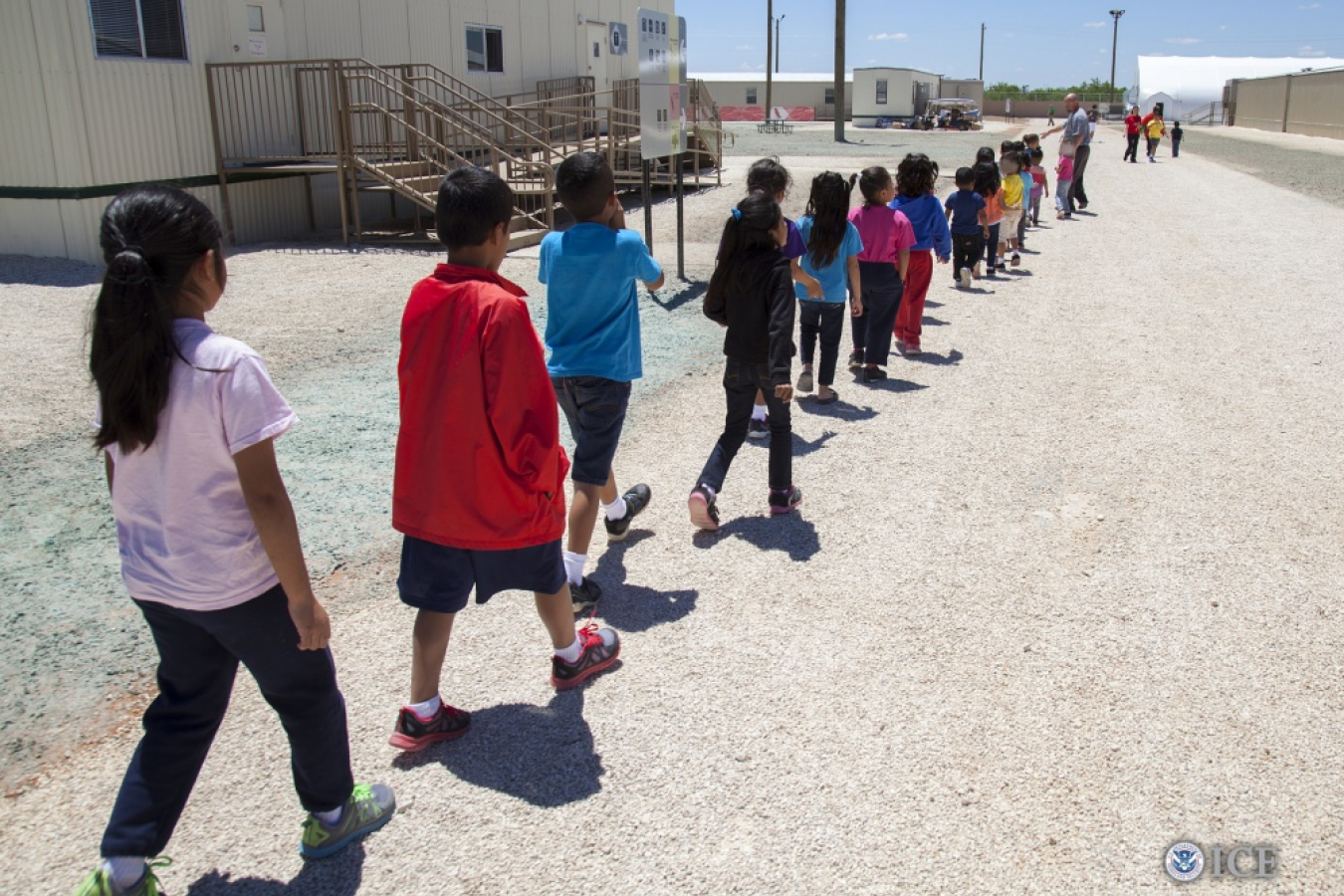 Children walk to classrooms at the South Texas Family Residential Center