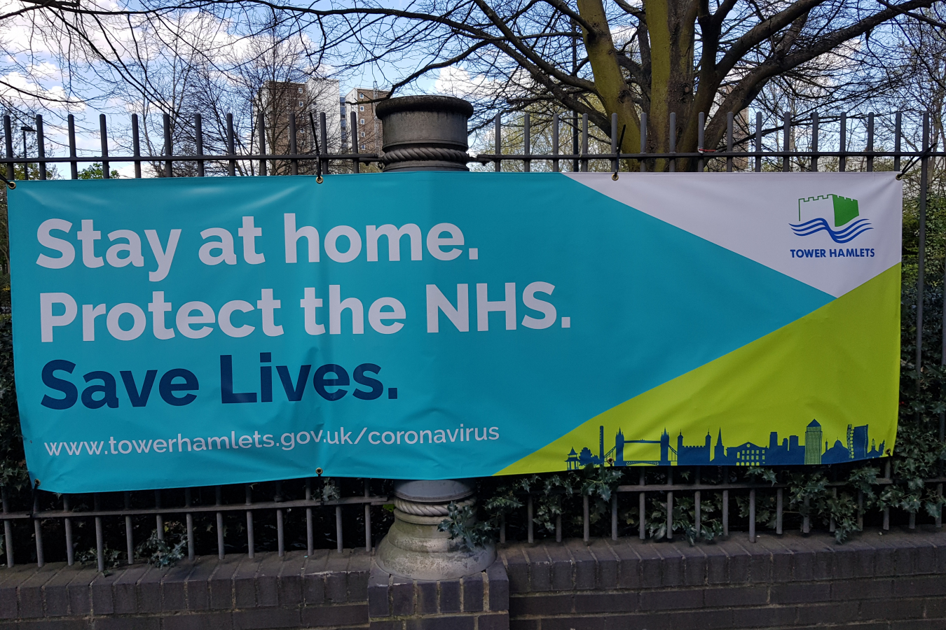 Stay at Home Protect the NHS sign, near Canary Wharf, London