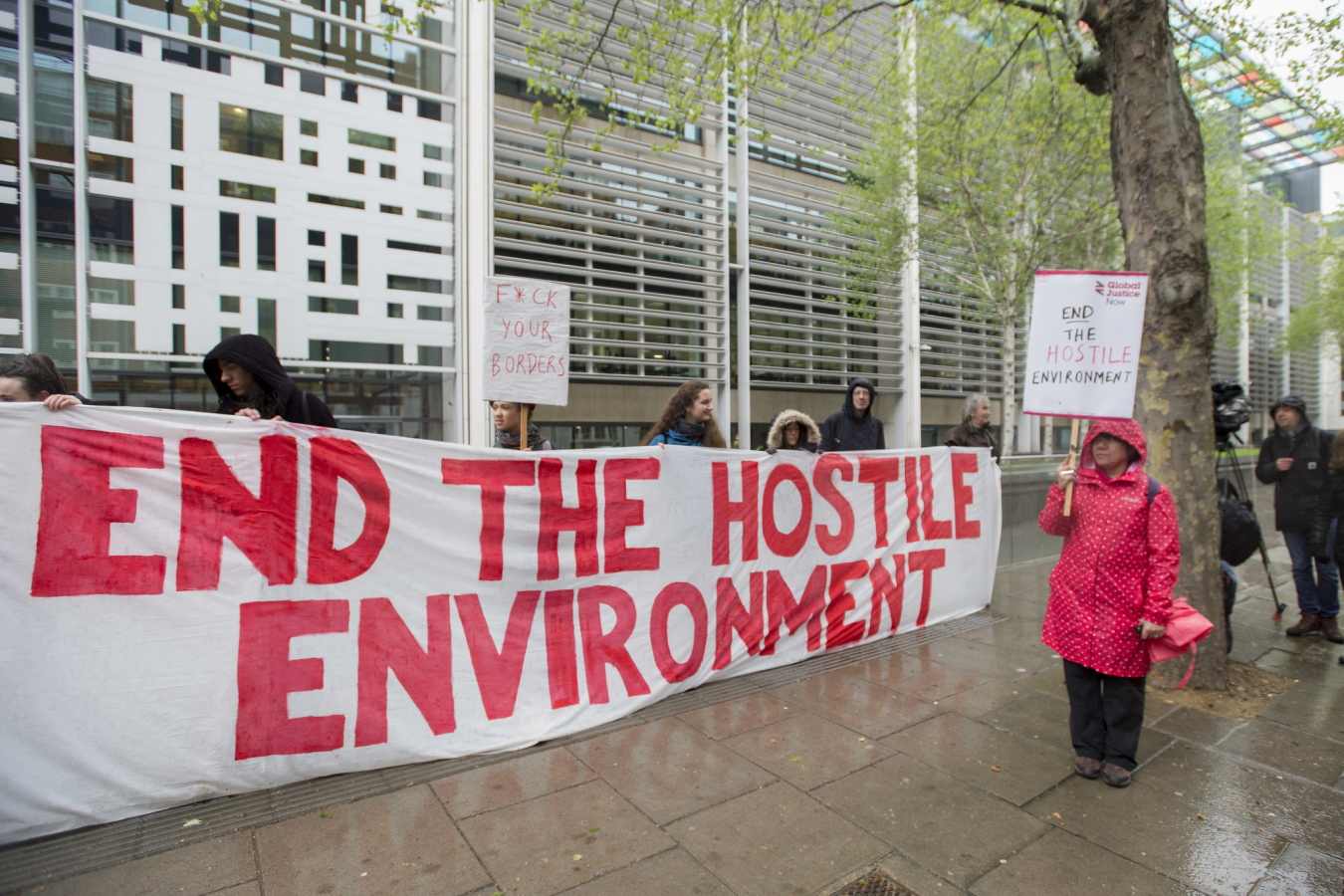 Monday April 30, 2018. Protestors from Global Justice Now demonstrate outside the Home Office in London demanding an end to the Hostile Environment policy.
