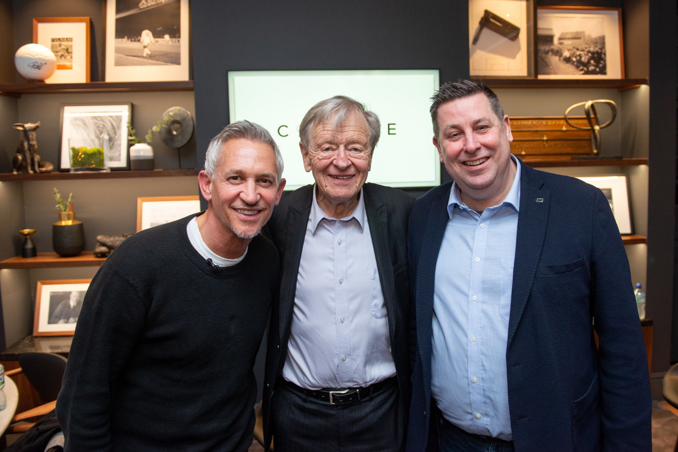 Lord Dubs (centre) with Gary Lineker - Fulham Football Club where refugee children take part in football training sessions March 5, 2020