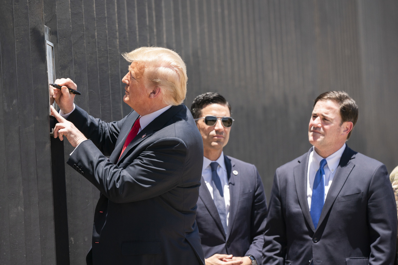 President Donald J. Trump signs a plaque Tuesday, June 23, 2020, commemorating the 200th mile of new border wall along the U.S.-Mexico border.