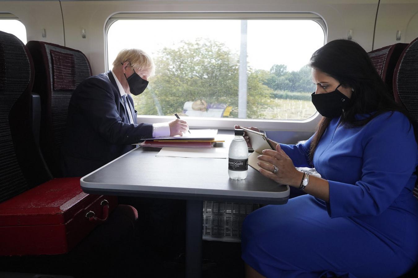 Boris Johnson Prime Minister and Priti Patel Home Secretary working on the Train 30 July 2020