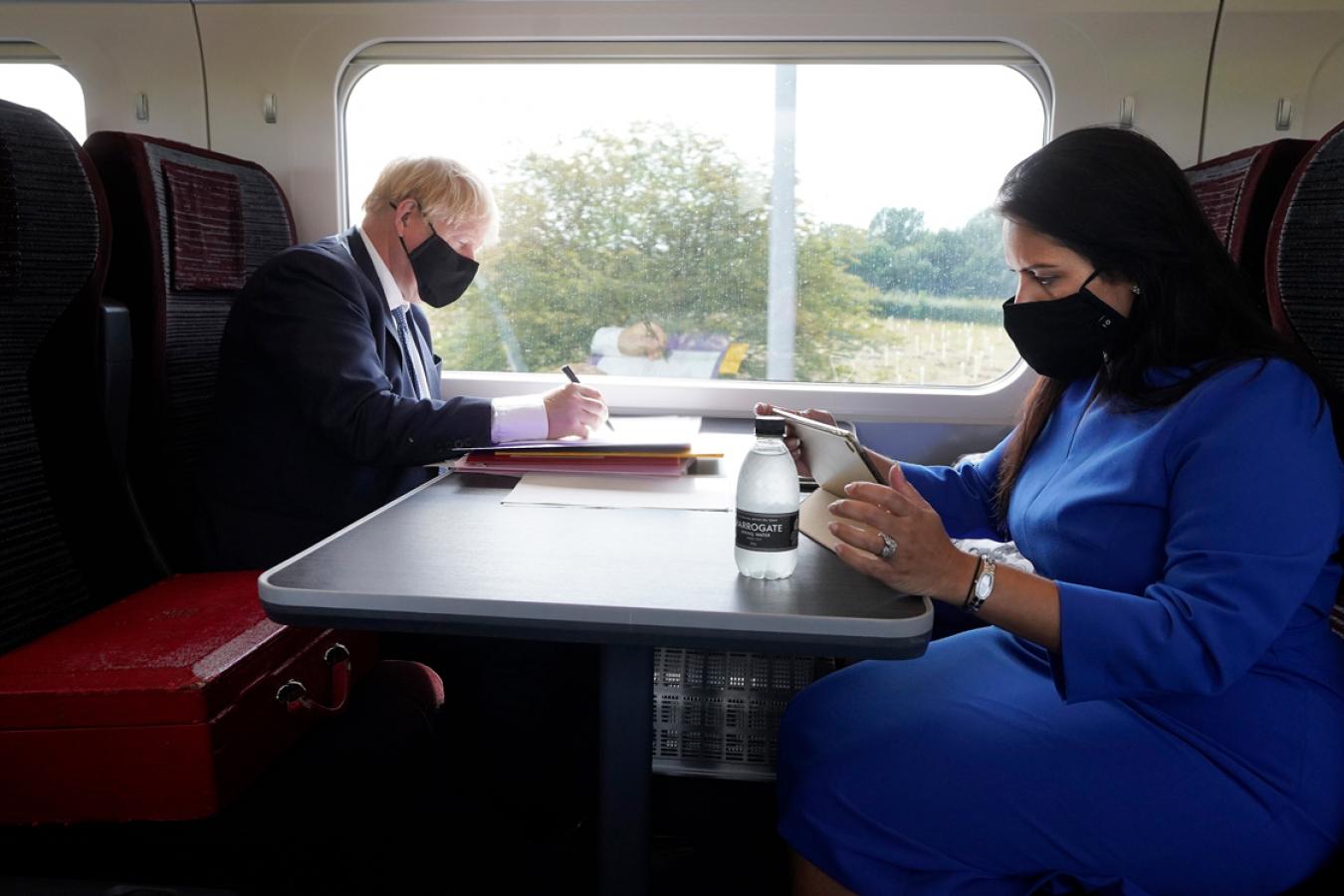 Boris Johnson and Priti Patel working on the Train